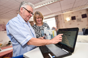 Carer Keith Harding and manager Irene Rouse put the new medications system to use at Shrewsbury's Coton Hill House