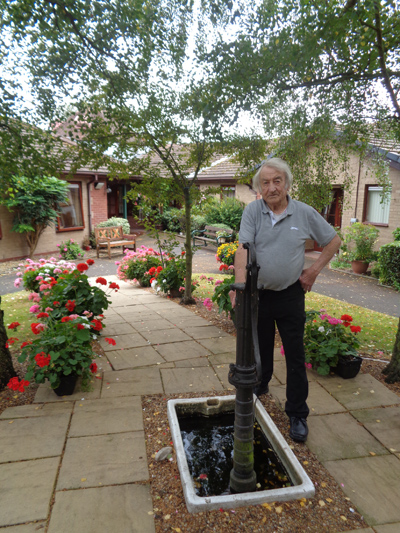 Ron Dykes in the grounds of the award winning garden that he tends