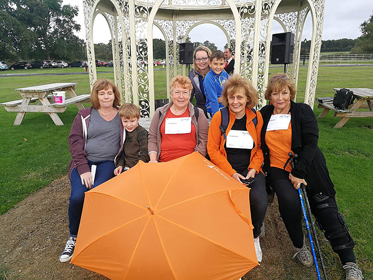 Care staff put best foot forward in charity walk