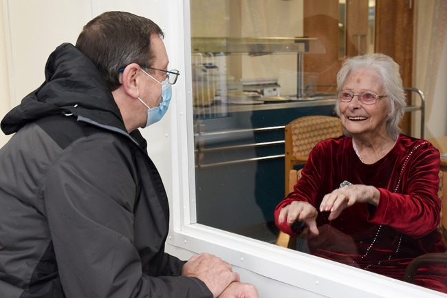 son-visits-mum-in-care-home